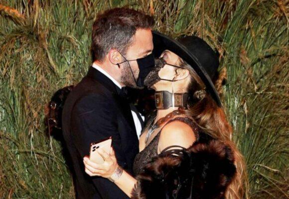 Jennifer Lopez and Ben Affleck share a masked kiss at Met Gala
