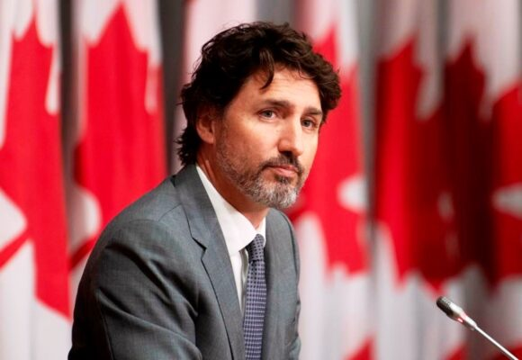 Justin Trudeau hangs on to power in Canadian election to form minority government